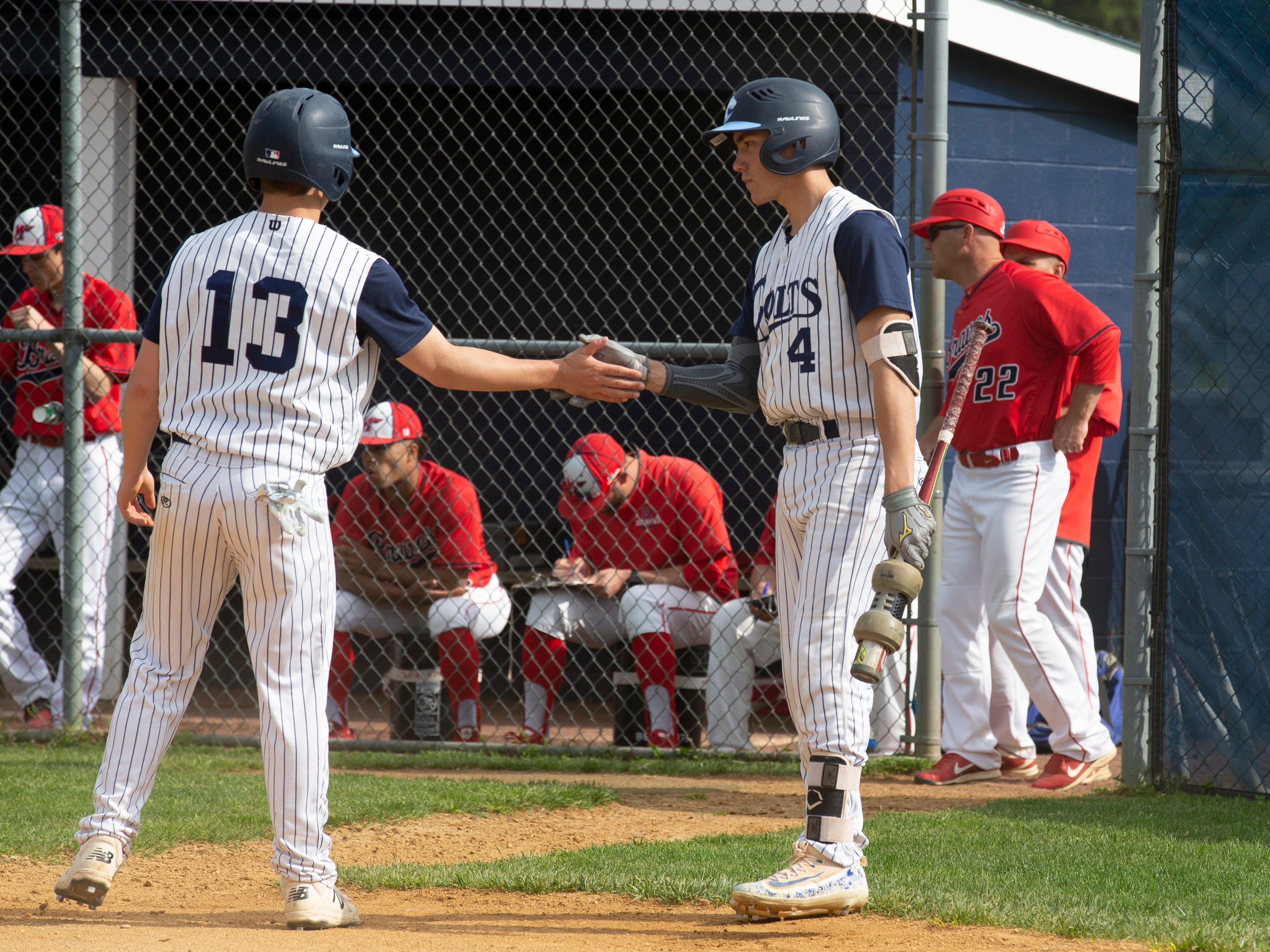 CBA's Declan Hoverter shakes hands with Pat Reilly after scoring his team's first run of game Manalapan baseball vs Christian Brothers Academy in Middletown NJ. On May 2, 2019.