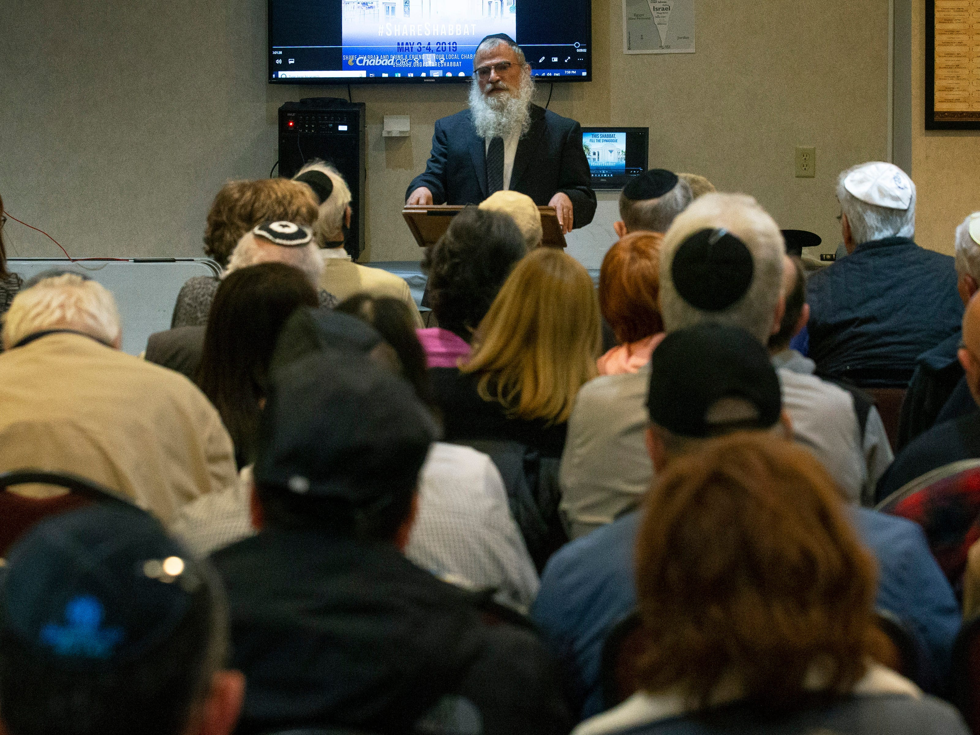Rabbi Avraham Bernstein talks to audience at Jewish Memorial and Solidarity gathering at Chabad of Western Monmouth County in  Manalapan in response to the carnage that took place in Poway, CA this past week.