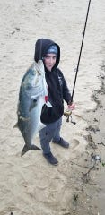 Justin Murphy, 16 of Toms River, with a bluefish he landed at Manasquan Inlet.