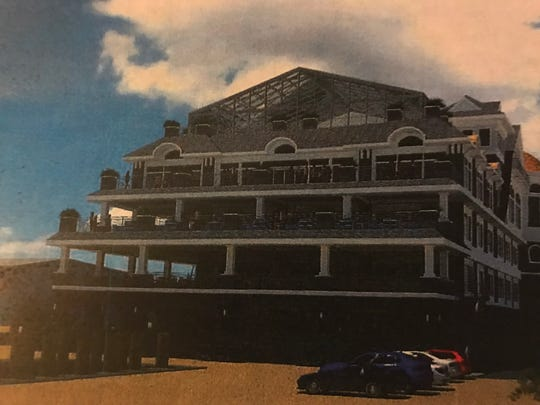 An architect's rendering shows a banquet hall and restaurant proposed for the site of a marina at the base of the Mantoloking bridge.