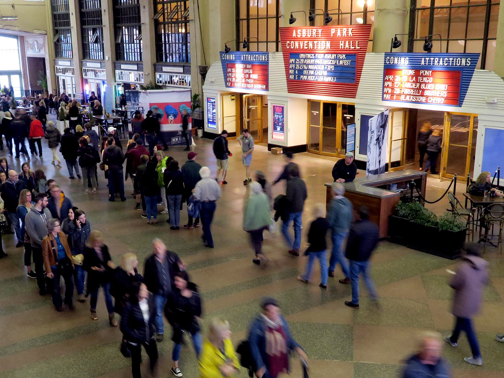 """The crowd winds through the concourse between Convention Hall and the Paramount Theatre Thursday night, April 25, 2019, where a screening of the film """"Echo In The Canyon"""" was being screened at the Asbury Park Music + Film Festival."""
