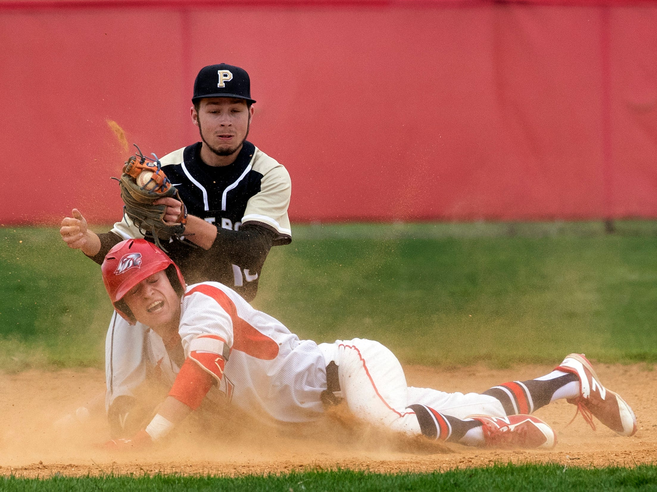 Point Pleasant Boro's Nicholas Zbikowski tags out Liberty's  Connor Keenan for a first inning out. Point Pleasant Boro Baseball vs Jackson Liberty in Jackson, NJ on May 1, 2019.