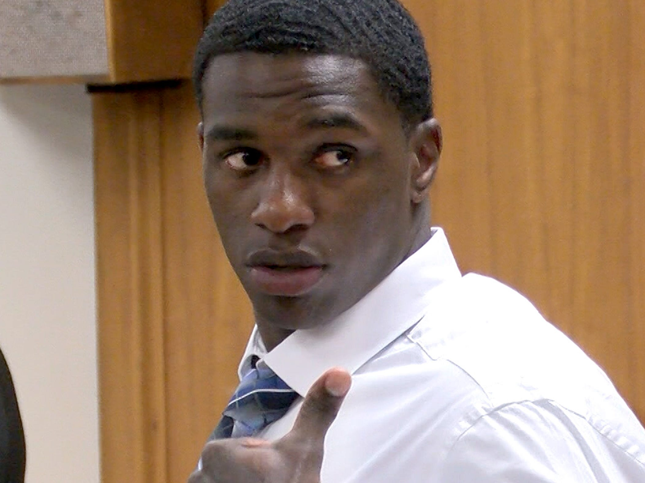Dante Allen gives a thumbs up to people in the gallery during his attempted murder trial in State Superior Court in Freehold Tuesday, April 30, 2019.  He is charged with shooting at Asbury Park police Officer Terrance McGhee during a foot chase.