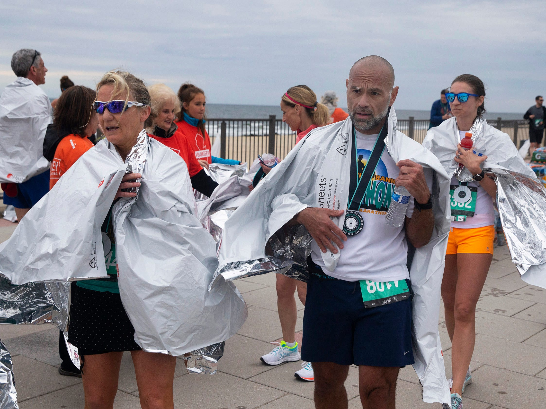 Runners get thermal wraps to keep warm after finishing marthon. 2019 Novo Nordisk New Jersey Marathon and Half Marathon which started at Monmouth Park in Oceanport and ended at Ocean Promenade in Long Branch.