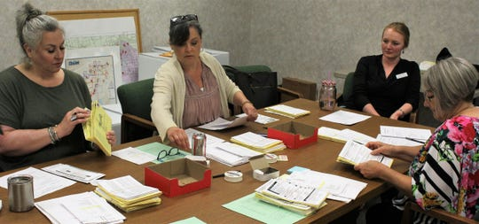 Election Judge Lara Carlin, second from left, joined three others Thursday to gather mailed-in ballots in preparation for Saturday's election in Taylor County.