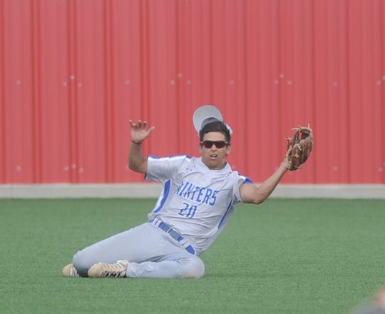 Winters left fielder Trent Hamilton makes a sliding catch during Game 1 of a bi-district playoff series with Haskell on May 1, 2019, at Cardinal Field in Hermleigh.
