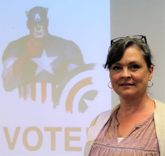 Like Captain America, Taylor County election judge Lara Carlin urges residents to exercise their right to vote.