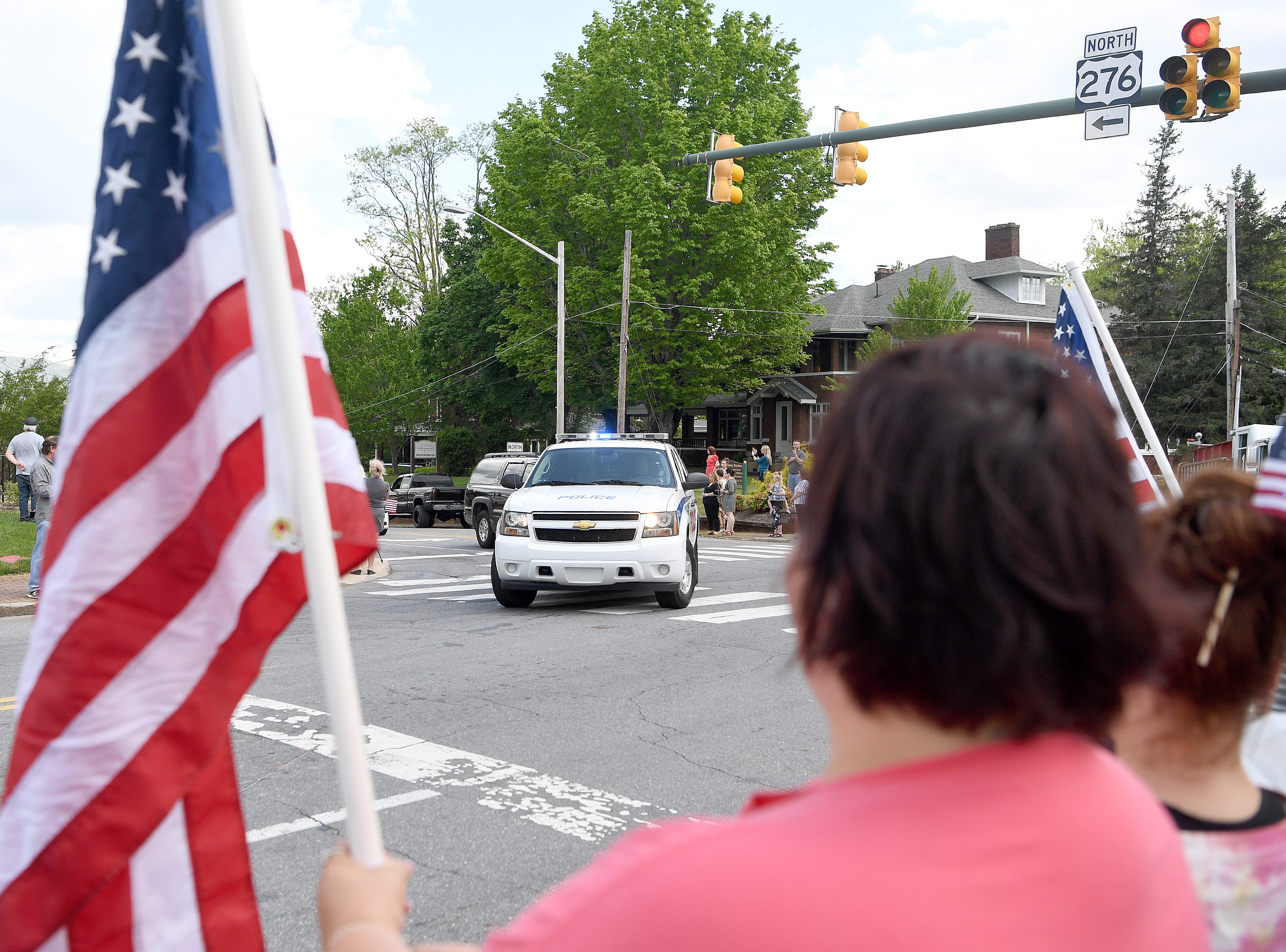 Police escort the body of UNC Charlotte shooting victim Riley Howell to Wells Funeral Home in Waynesville where they he was received by a hero's welcome on May 2, 2019. Police say that Howell's actions during the shooting cost him his life and saved the lives of others.