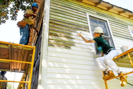 """Smith Tucker, left, and Madisen Jones work on restoring the birthplace of Nina Simone in Tryon May 2, 2019. """"She gave to us so it is nice to give back to her,"""" said Jones."""