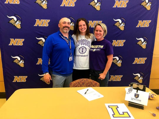 North Kitsap's Raelee Moore (center) signed her national letter of intent with Lipscomb University this week. Moore is pictured with Vikings coaches Dave Snyder and Kim Selembo.