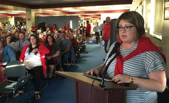 Rebecca Chandler, a nurse in South Kitsap School District, warns the school board that plans to cut positions, including a school nurse, could put students with severe health challenges and life-threatening conditions at risk. Chandler spoke at a school board meeting May 1, 2019, at South Kitsap High School.