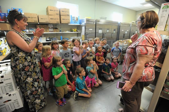 Swannanoa Valley Christian Ministry executive director Cheryl Wilson thanks Noelle Harralson's class, from Black Mountain Primary, for their delivery of over 1,200 food items on May 2.