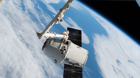 On July 2, 2018, a SpaceX Dragon cargo craft is pictured moments after being captured with the 57.7-foot-long Canadarm2 robotic arm controlled by NASA astronaut Ricky Arnold as the International Space Station orbited over Quebec, Canada, during SpaceX's CRS-15 resupply mission.