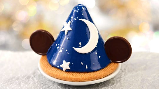 The Sorcerer's Hat, a lemon sponge cake with vanilla swiss buttercream, lemon curd, and white chocolate glaze is offered at Disney's Hollywood Studios starting May 1. The 30th anniversary of Disney's Hollywood Studios celebrates new attractions, entertainment, and merchandise, plus an incredible menu of limited-time offerings as well as legacy menu items that have been offered since the park opened.
