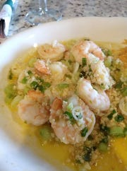 Caitlin Eva Creed raves about the garlicky mojo shrimp at Senior Loco on Eau Gallie Boulevard beachside.