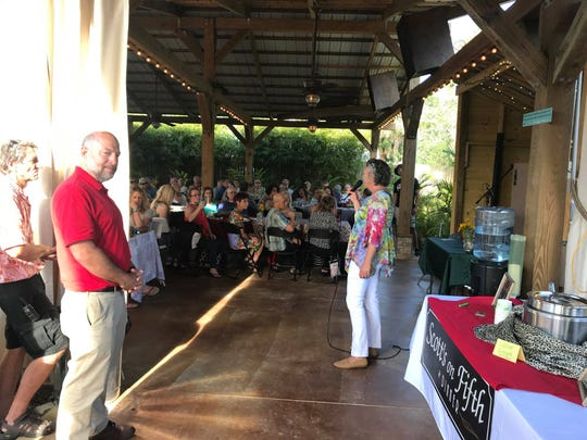 Jeff JeffNjus of Daily Bread listens as Theresa Riley of Rockledge Gardens talks with guests at the recent Empty Bowls event.