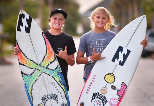Ten-year-old fraternal twins Beckham, left, and Daya McCart of Indialantic,  who follow in their dad's and uncle's surfing accomplishments.
