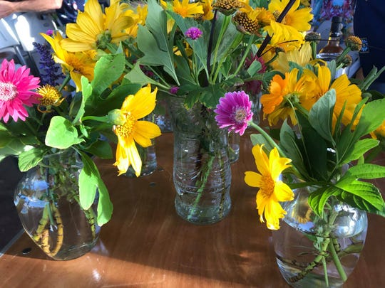 Colorful flowers cut from the Rockledge Gardens nursery decorated tables at the Empty Bowls event.