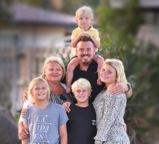 The McCart family of Indialantic: Mom and dad Cristle and Jaden, with their 10-year-old surfing twins Daya and Beckham (front left), 2-year-old son Aris (top) and 15-year-old daughter Reese,  who plays soccer and lacrosse.