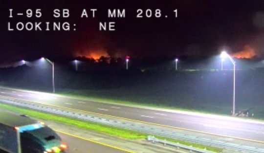 This Interstate 95 traffic camera shows the Tiger Fire burning Wednesday night near the Port St. John Parkway.