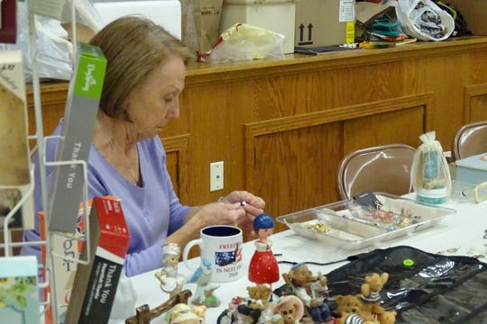 Dianna Zaebst prepares some jewelry items for the rummage sale on Wednesday at St. Paul's Lutheran Church. The sale continues through Saturday.