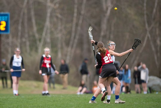 Champlain Valley's Ava Bartlett (20) and Mount Mansfield's Allison Charland square off for a draw control during Wednesday's girls lacrosse game in Jericho on May 1, 2019.