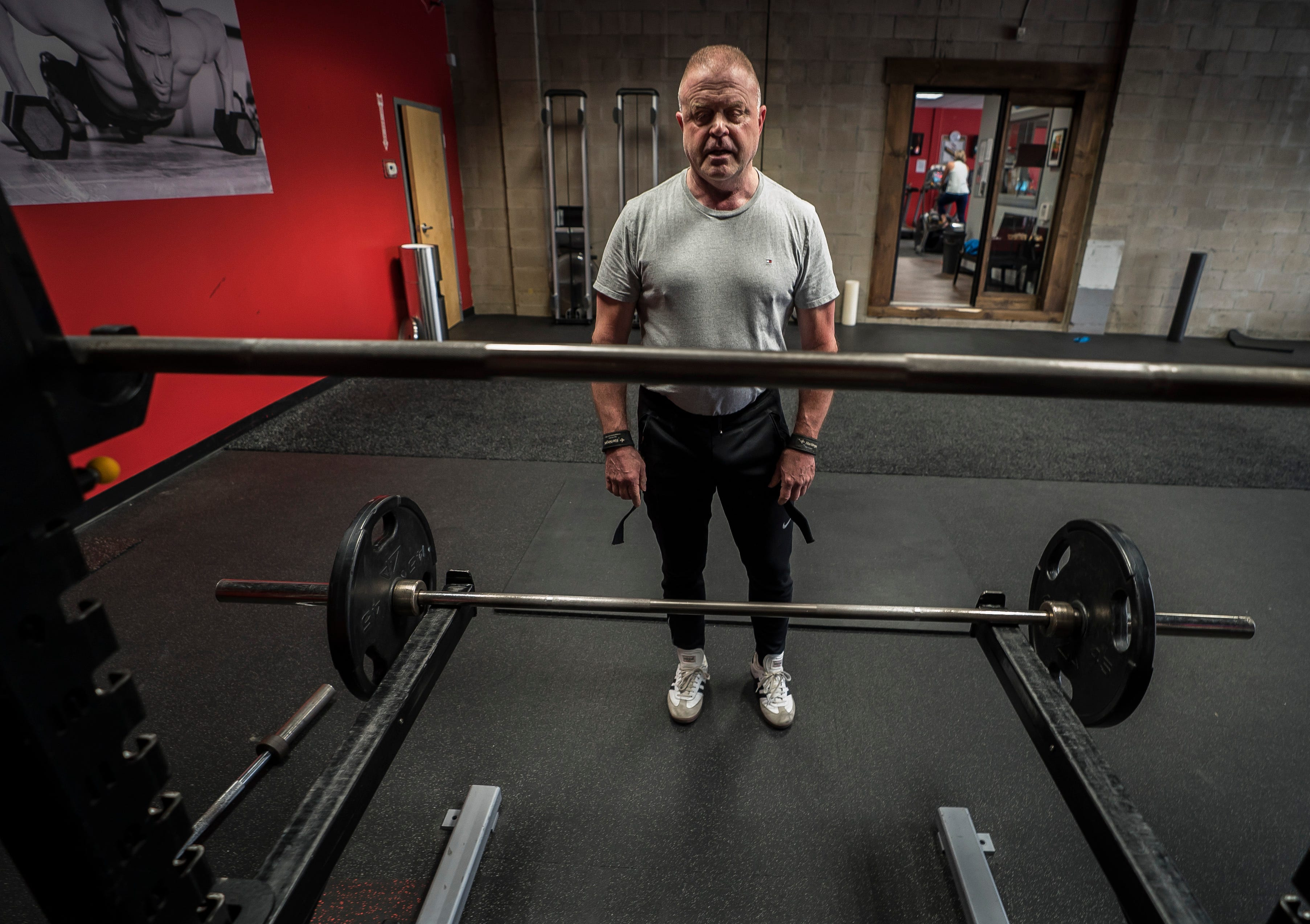 Michael Lowe finishes his daily workout at Snap Fitness in Berlin on Tuesday morning, April 30, 2019. Lowe's struggles with addiction exploded into the public's view in 2009 while serving at the Vergennes Police Chief. After years of struggling with opioid addiction that led to Lowe abusing other drugs as well as alcohol, he says he's finally in a healthy place and now works with people suffering from mental health issues.