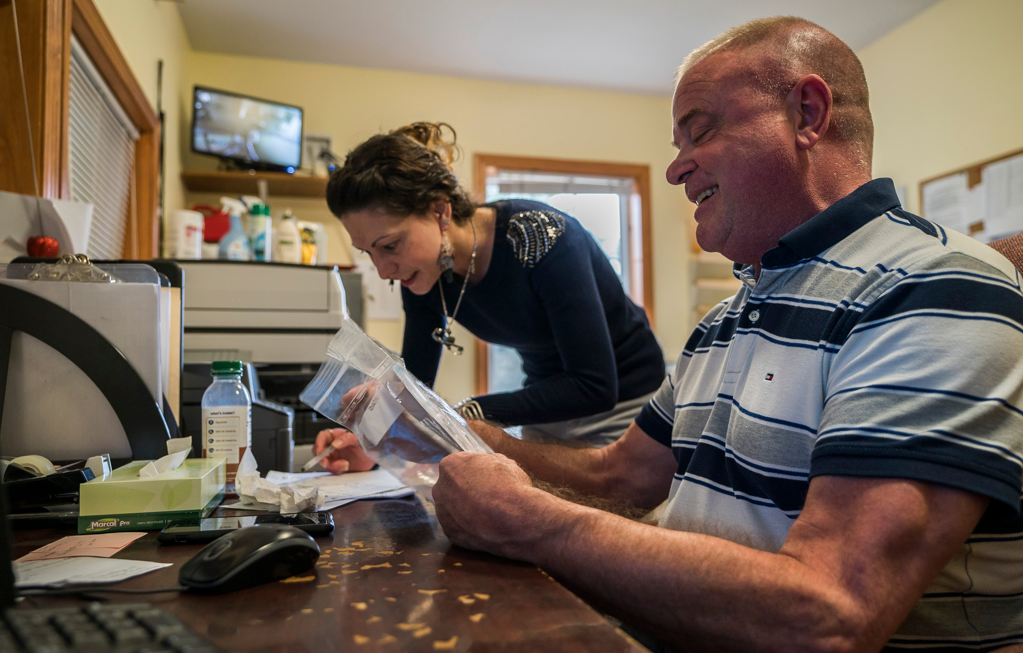 Michael Lowe processes intake paperwork with Assistant Manager Chelsea Lamore for a new client at the Oasis House in Hyde Park, a Lamoille County Mental Health Facility that opened in 2013. Lowe is the only staffer still there who started when the in-patient mental health facility opened.
