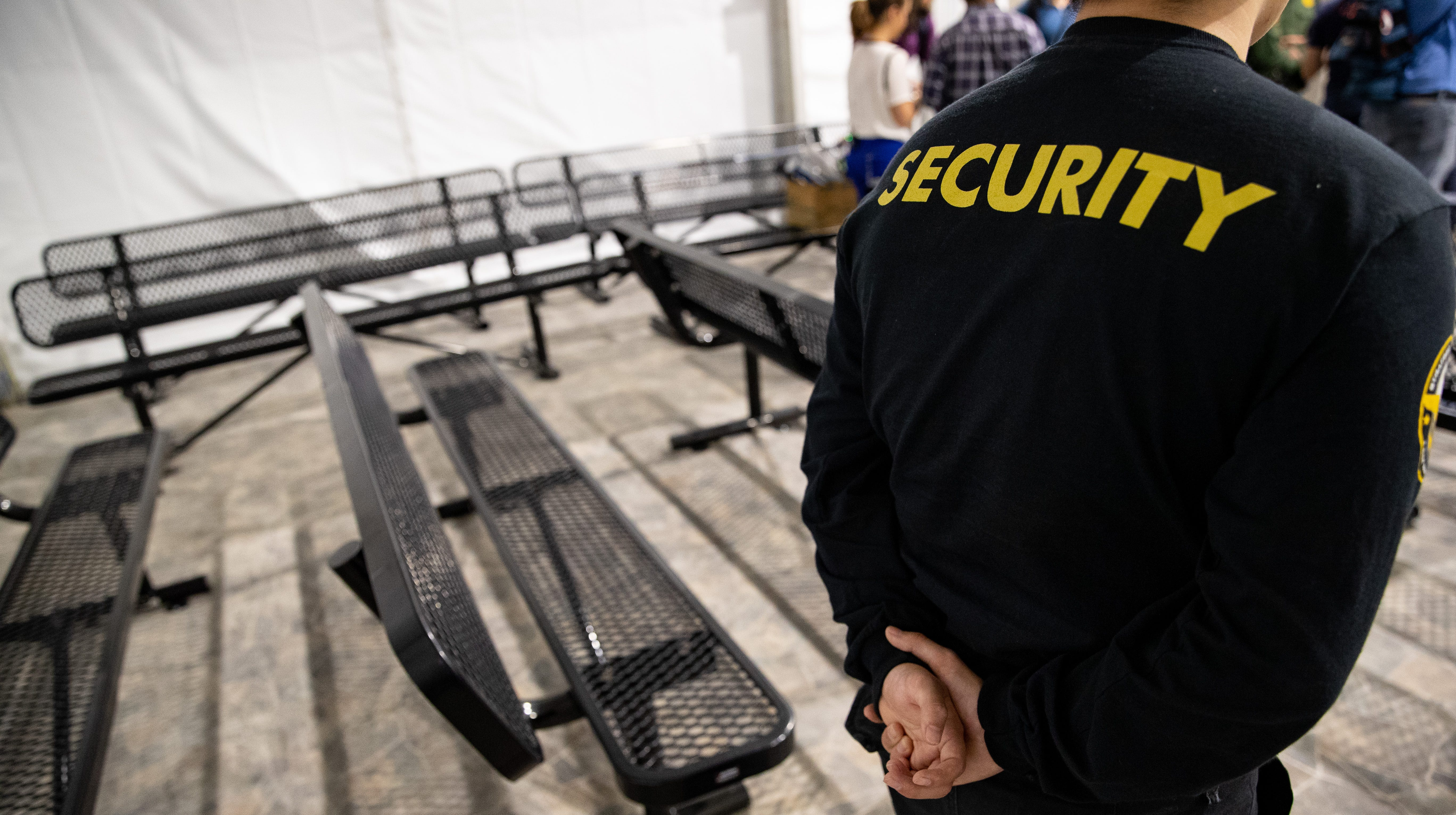 A security guard stands in the intake room at U.S Customs and Border ProtectionÕs new temporary detention facility for migrants near the Donna-Rio International Bridge in Donna Tx. on Thursday, May 2, 2019.