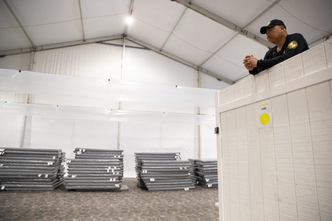 A guard stands on a platform in a dormitory that will sleep as many as 125 migrants in U.S Customs and Border ProtectionÕs temporary detention facility near the Donna-Rio International Bridge in Donna Tx. on Thursday, May 2, 2019.