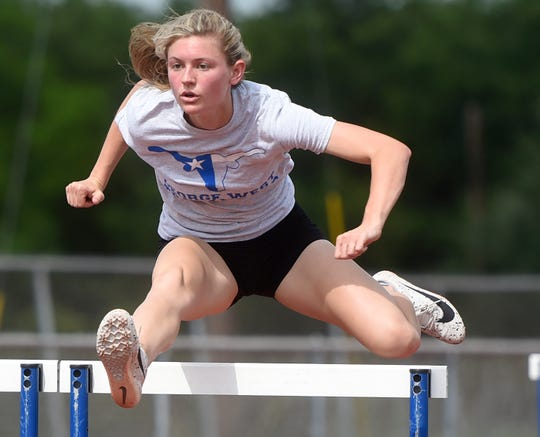 Faith Townsend practices for the upcoming state track and field meet, Thursday, May 2, 2019, at George West. Townsend won the girls' regional's 3A 100 meter hurdles with a time of 15.11.