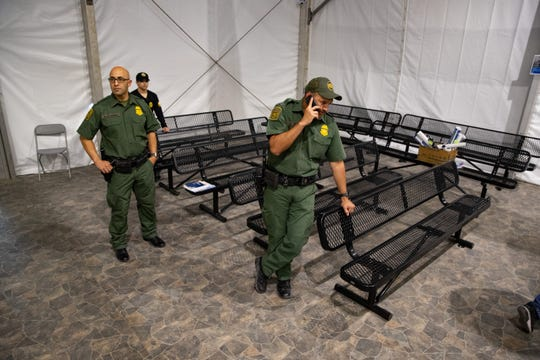 Customs and Border Protection agents in the intake room at U.S Customs and Border Protection's new temporary detention facility for migrants near the Donna-Rio International Bridge in Donna, Texas, on Thursday, May 2, 2019.
