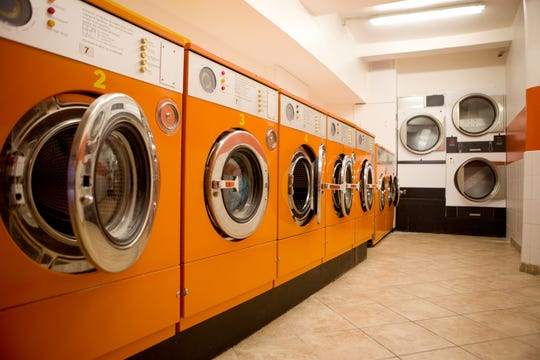 Authorities say an Atlantic City laundromat was being used to launder millions in drug proceeds. The leader of the drug-trafficking ring has been sentenced to 22 years in prison.