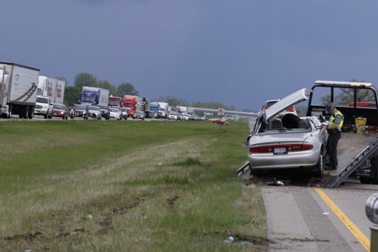 An Ohio Highway Patrol trooper investigates a crash that temporarily blocked traffic on U.S. 35 east and west Thursday afternoon outside Frankfort, Ohio.