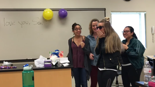 Savannah Allen  puts on glasses enabling her to see color for the first time. The glasses were a gift from her UC Blue Ash College classmates in the dental hygiene program.