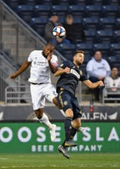 FC Cincinnati defender Kendall Waston (2) and Philadelphia Union forward Kacper Przybylko (23) head the ball during the first half at Talen Energy Stadium.