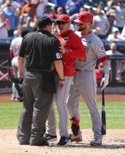 May 2, 2019; New York City, NY, USA; Cincinnati Reds manager David Bell (middle) is ejected after arguing with home plate umpire Marty Foster (60) after Cincinnati left fielder Jesse Winker (33) was also ejected during the ninth inning against the New York Mets at Citi Field. Mandatory Credit: Brad Penner-USA TODAY Sports