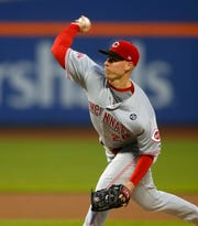 Cincinnati Reds starting pitcher Anthony DeSclafani (28) throws the ball against the New York Mets in the first inning at Citi Field.