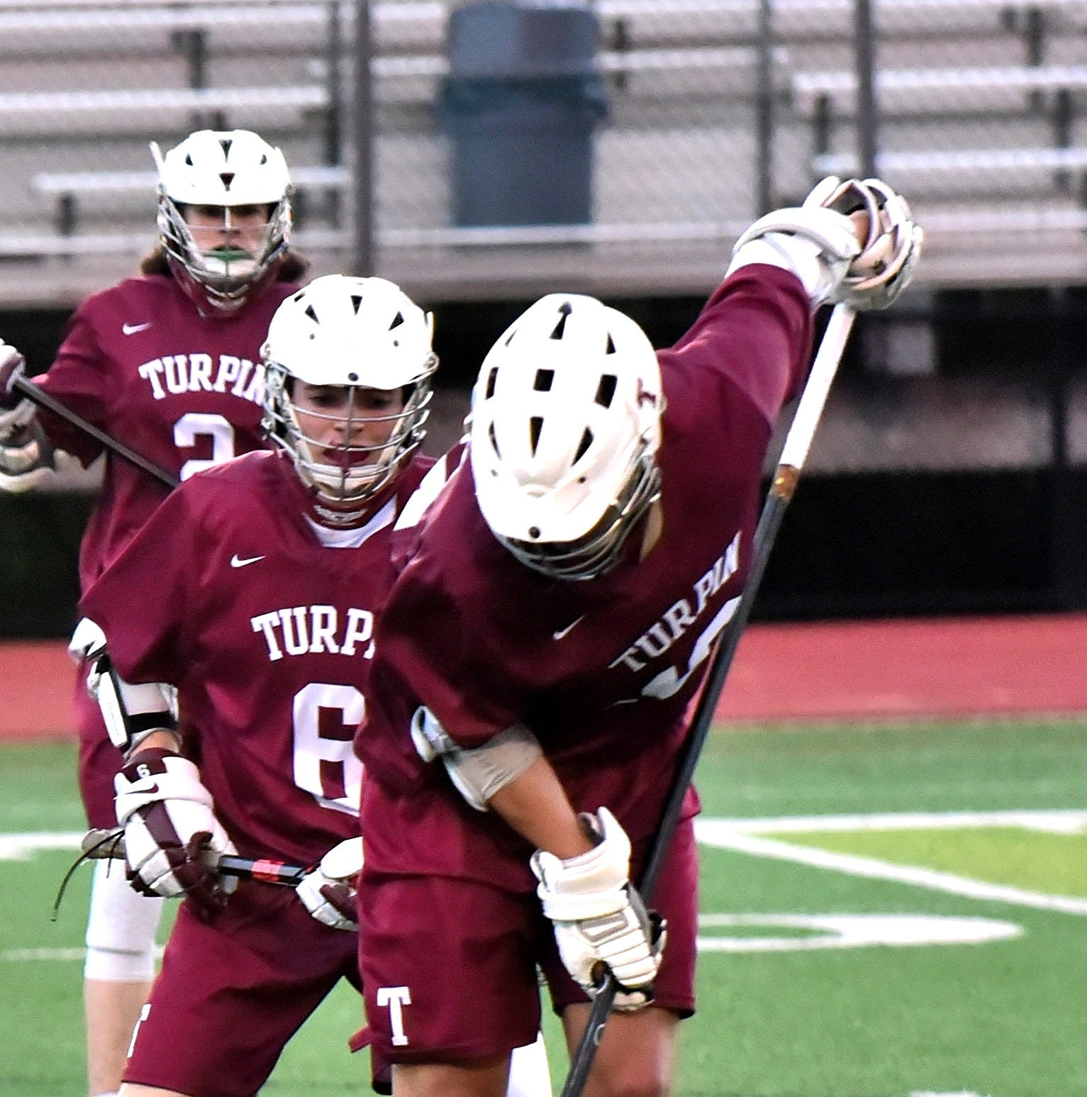 Cole Kueper of Turpin scoops and controls the ball on defense for the Spartans at the Kings Senior Night Boys Lacrosse matchup against Turpin, May 1, 2019.