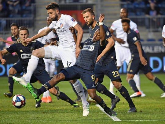 FC Cincinnati defender Mathieu Deplagne (17) and Philadelphia Union forward Fafa Picault (9) battle for the ball during the first half at Talen Energy Stadium.