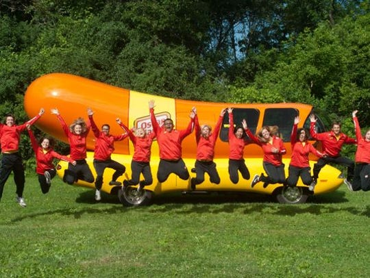 Wienermobile drivers show their enthusiasm.
