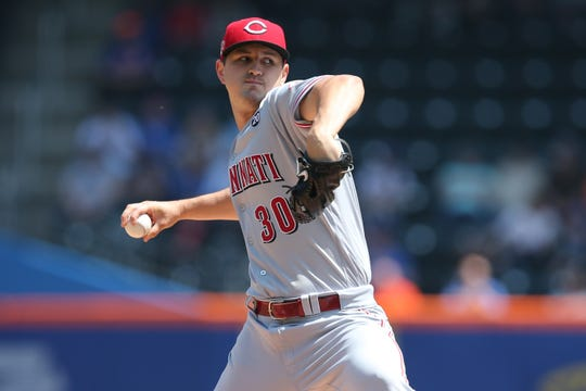 Cincinnati Reds starting pitcher Tyler Mahle (30) pitches against the New York Mets during the first inning at Citi Field.