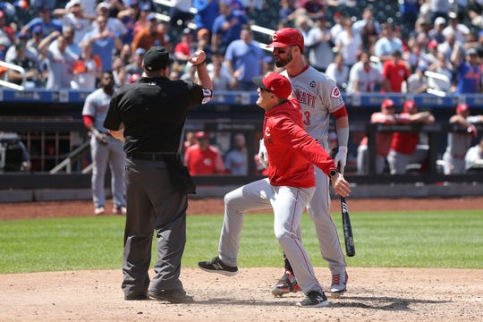 Cincinnati Reds manager David Bell (middle) is ejected after arguing with home plate umpire Marty Foster (60) after Reds left fielder Jesse Winker (33) was also ejected during the ninth inning against the New York Mets at Citi Field.