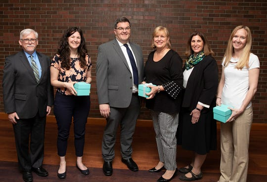 Three professors at Middlesex County College were recently honored: Alexandra Fields, assistant professor in the History and Social Sciences Department, was selected as the 2019 Faculty Scholar; Hope-Claire Holbeck, assistant professor of dental hygiene, received the Excellence in Teaching Award; and Erin Nemiroff (Metuchen) of the English Department received the Excellence in Teaching Part Time Award. (Left to right) College President Mark McCormick, who presented the Scholar Award to Fields; Jeffrey Herron, vice president for academic and student affairs, who presented the Teaching Award to Holbeck, and Linda Scherr, dean of arts and sciences, who presented the Part-Time Teaching Award to Nemiroff.