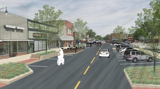 This streetscape concept by Bolton & Menk for the Indianola downtown square business area features parallel parking next to shops, angled parking closer to the courthouse, and greenspace with two-way streets.