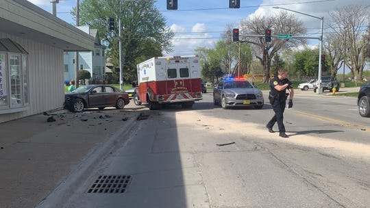 Iowa State Patrol and Des Moines Police Department officials investigate Thursday, May, 2, 2019 a crash at the intersection of Second and Douglas avenues on Des Moines' north side. An Audi A4, left, collided with students getting of a DART bus after the Audi was struck by a Hyundai Sonata. Troopers say the driver of the Sonata has been cited and the victims are expected to survive.