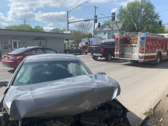 A damaged Hyundai Sonata, foreground, is seen Thursday, May 2, 2019 at the intersection of Second and Douglas avenues on Des Moines' north side. The car crashed into an Audi A4, far background, sending the vehicles off the roadway. Three minors getting of a DART bus were hit in the aftermath, but are expected to survive, Iowa State Patrol troopers say. The driver of the Sonata has been cited.