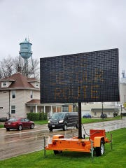 A sign warns drivers of an impending detours along Altoona's First Avenue. A nearly quarter-mile portion of the roadway will shut down Monday as crews widen the roadway from one lane in either direction to two.