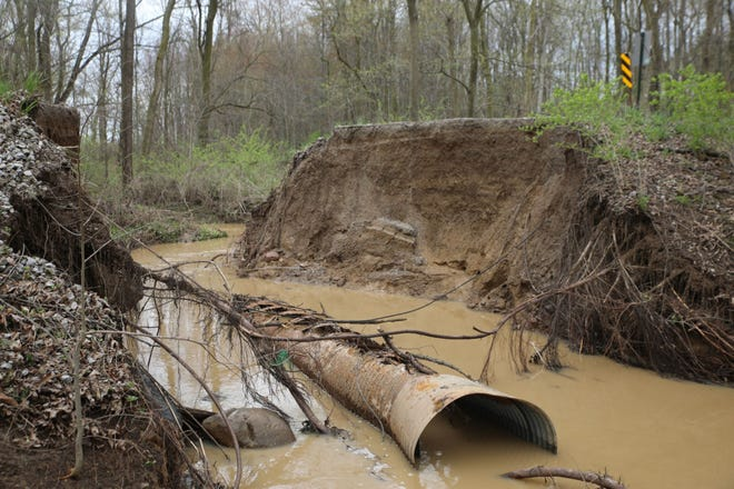 A portion of Braun Road in Saline Township collapsed Wednesday morning, May 1, 2019, after periods of heavy rain. A culvert pipe underneath the road was aging and may have contributed to the road collapse.