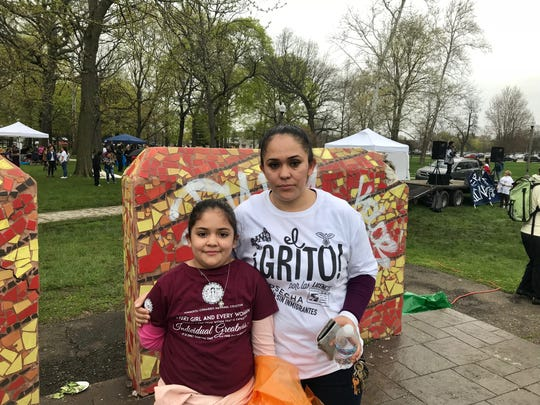Maria Flores, 38, of Detroit, attends rally with her daughter in Clark Park on May 1, 2019, asking the state of Michigan to allow undocumented immigrants to get driver's licenses. She said her husband was pulled over by police in Macomb in October and then detained by ICE  because he didn't have a driver's license and is an undocumented immigrant.